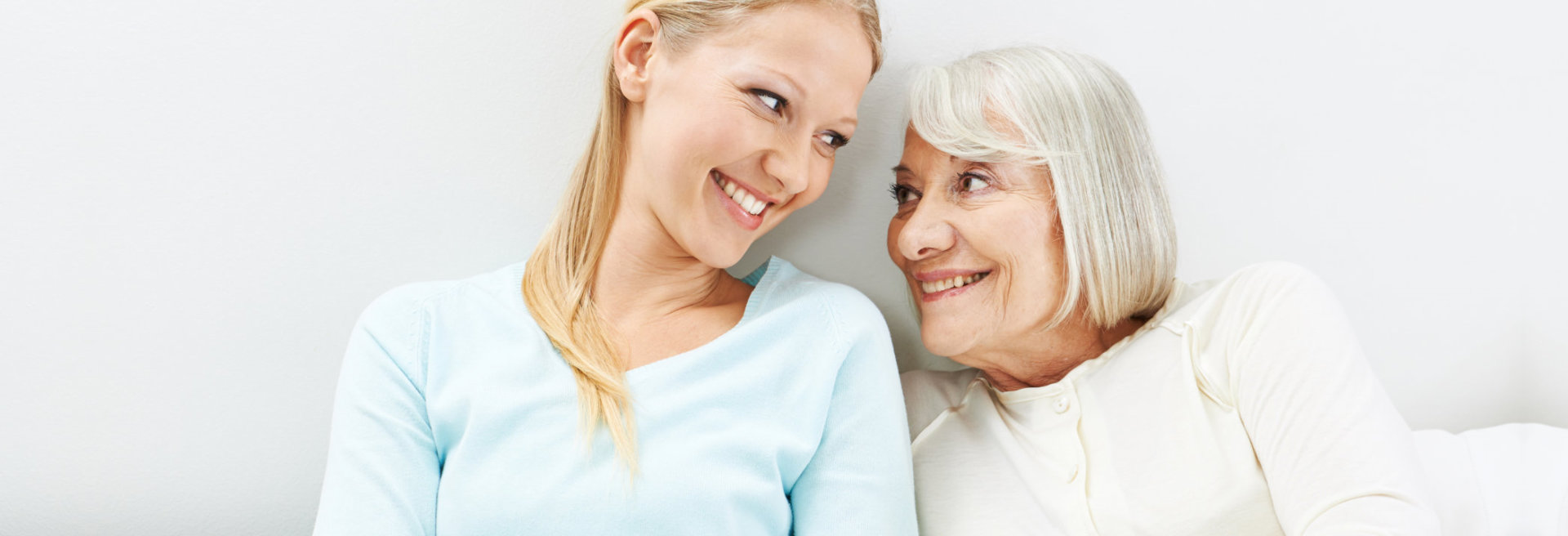 lady and old woman smiling at each other