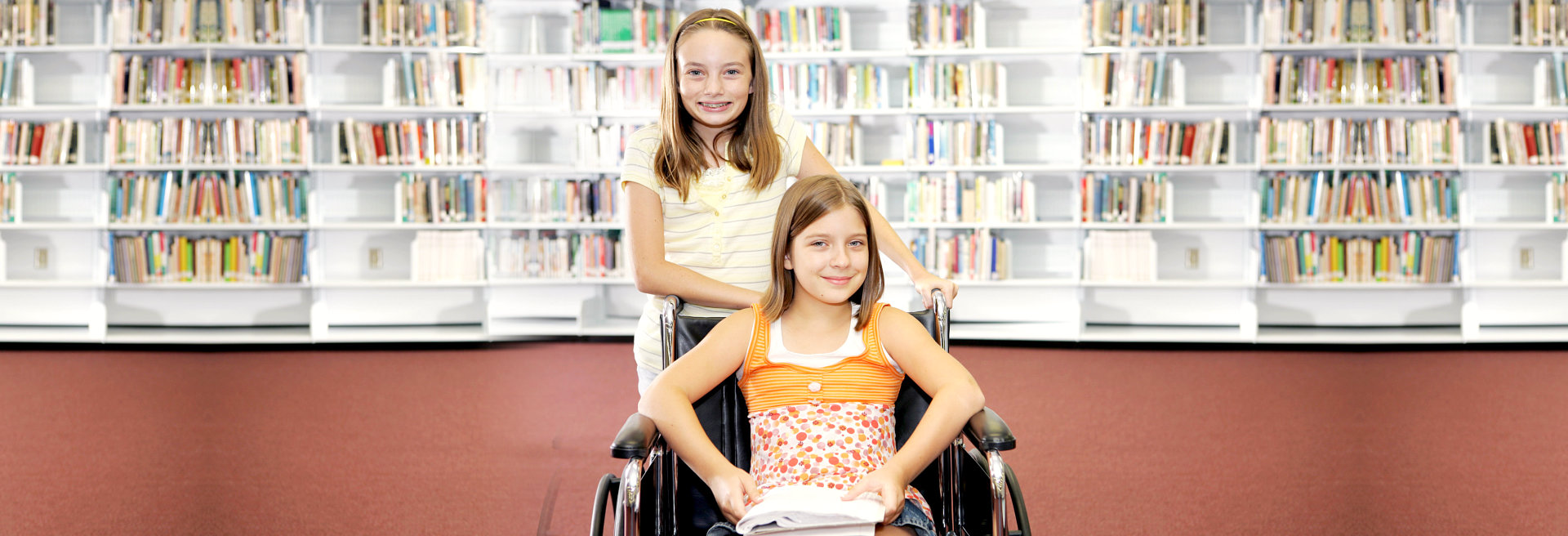 girl on a wheelchair with her friend